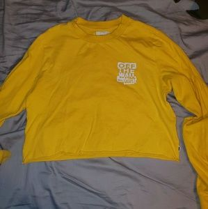 Long sleeve yellow Van's crop top